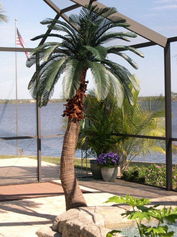 <h6>9' Queen Palm</h6>Tropical Expressions curved artificial palm tree has been our top seller since 1999. Live palm trees were removed from Homestead Florida and brought back to our manufacturing shop for mold work.<p>This curved palm was picked for its natural beauty and